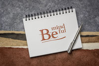 Be mindful note in a sketchbook