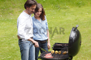 Couple cooking on barbecue