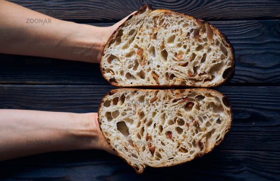 Homemade tartine bread in woman's hands