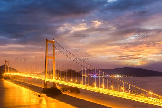 bridge spanning the sea in nightfall