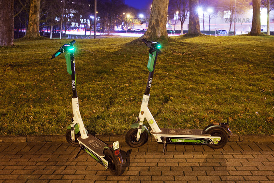 E-scooters from Limebike in the evening, Dortmund, North Rhine-Westphalia, Germany, Europe