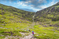 Group of hikers starting to climb Devils Ladder to reach Carrauntoohil mountain