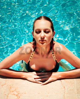 Young fashionable woman in the pool