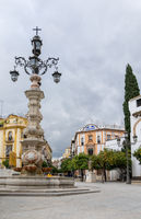 town square and historic fountain and buildings in the historic old city of Seville