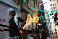Kolkata, India, A rickshaw puller in the streets of the Muslim quarter