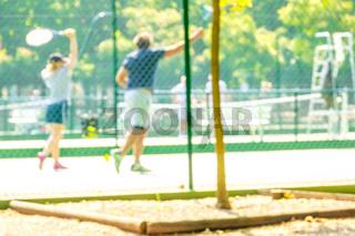 Tennis Training on the Summer Court. Defocused