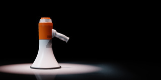 Bullhorn Spotlighted on Black Background