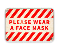 Bright glossy red and white metal plate, please wear a face mask, warning sign on white