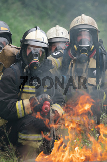Firefighters of Fire Department Federal Fire Service during fire extinguishing, training to overcome fire zone of psychological training for firefighters