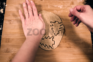 Top view of woman's hands making gingerbread