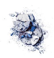 Crushed eyeshadows and powder isolated on white background