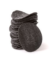 Stack of of black potato chips