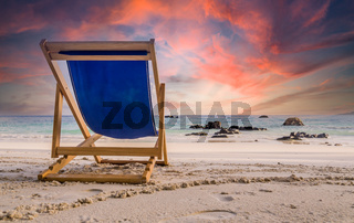 Amazing sunset watched from deck chair at white beach in Ko Lipe, Thailand
