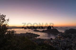 Sunrise from Mirante Dona Marta in Rio de Janeiro overlooking Sugarloaf Moutain and Guanabara Bay.