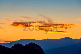 Mountain Peaks and Golden Post-Sunset Sky