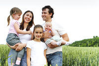 Cheerful happy family in wheat field