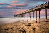 Sunset over Scripps pier Beach in La Jolla