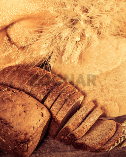 White and black bread on the wooden table