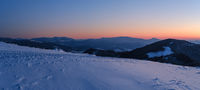 Picturesque winter alps sunrise. Panoramic mountains view from Svydovets ridge and Dragobrat ski resort.