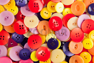 A pile of colorful buttons viewed from above