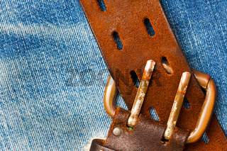 unfastened old leather belt with vintage buckles