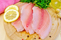 Tilapia with parsley and lemon on board