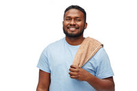 smiling african american young man with bath towel