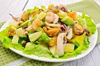 Salad seafood and avocado on light board