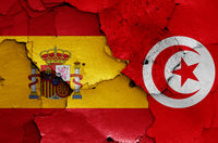 flags of Spain and Tunisia painted on cracked wall
