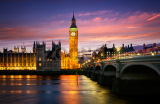 Big Ben Palace of Westminster at sunset with Thames River in London, England