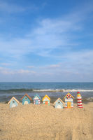 Miniature huts and lighthouse at beach