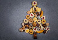 Christmas tree made from different cookies. Holiday background