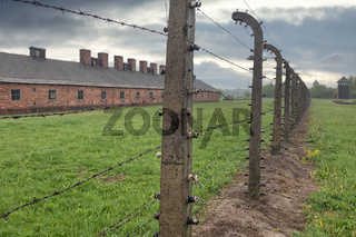 Buildings of concentration camp Auschwitz surrounded bij barbwire