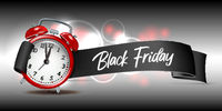 Curved paper banner ribbon with Black Friday inscription and realistic red alarm clock.