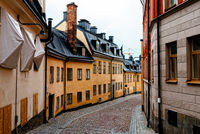 Picturesque cobblestoned street with colorful houses in Sodermalm in Stockholm