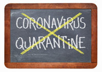 covid-19 quarantine cancelled - blackboard sign