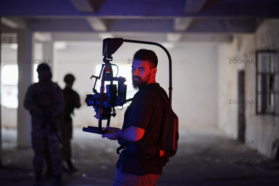 Videographer Taking Action Shoot of Soldiers in Action urban environment