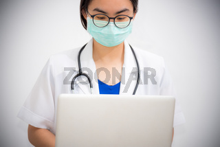 Doctor are working on a computer