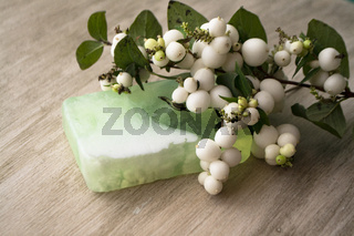 Handmade transparent green soap. Handcrafted Soap. Home made soap with white berries, organic homemade cosmetics and handmade soaps concept.
