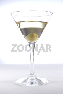Glass with martini and olive