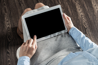 business woman with tablet on her lap