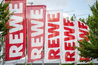 Flags with the logo of REWE