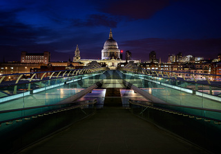 St. Paul's Cathedral and Millenium Bridge in London at night, in England