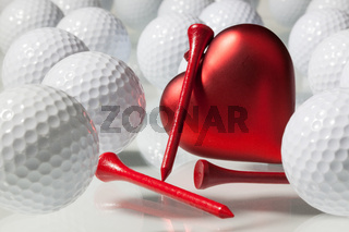 Many golf balls and red heart