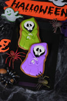 Painted Ghost in cape hooded on a honey gingerbread cookies. Halloween food