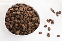 Bowl of caffee beans on a white background
