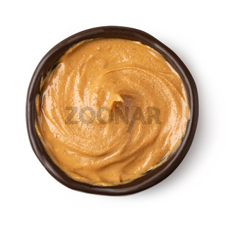 Glass bowl of peanut butter
