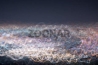 Abstract long exposure, experimental surreal photo, city and vehicle lights at night