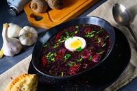 Delicious beetroot borscht with egg