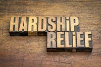 hardship relief word abstract in vintage wood type